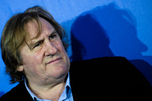 Gerard Depardieu has chosen to live in Belgium while Sebastien Loeb (left) and Richard Gasquet find Swiss tax rules more to their liking. Photo / AP