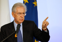 Italian Premier Mario Monti gestures as he speaks during a news conference in Rome. Photo / AP