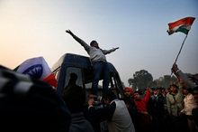 A protester climbs on the back of a police van during a violent demonstration near the India Gate against a gang rape and brutal beating of a 23-year-old student. Photo / AP