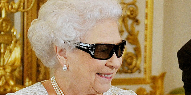 The Queen watches the recording of her Christmas message to the Commonwealth, which was broadcast in 3D for the first time. Photo / AP