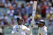 Kumar Sangakkara (left) celebrates 10,000 test runs at the MCG. Photo / AP 