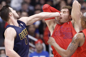 Los Angeles Clippers' star Blake Griffin wears the fist of Denver Nugget's Danilo Gallinari in the mush during their Christmas Day encounter.  Photo / AP