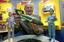 Gerry Anderson with Thunderbird 2 and the crew. Photo / AP