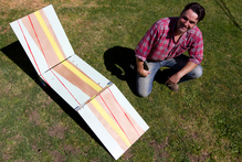 Justin Newcombe with finished portable lawn chair. Photo / Steven McNicholl