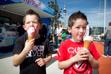 Six-year-old twins Blair (left) and Alex Gibson get stuck into icecreams at Auckland's Viaduct. Photo / Natalie Slade