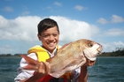 The perfect combination - a boy and a freshly caught fish. Photo / Russell Baker