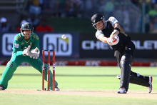 Brendon McCullum of New Zealand drives one into the waiting hands of Justin Ontong of South Africa. Photo / Getty Images