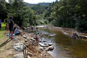 Campers enjoy the sunny weather and swim in the Wentworth River, which this time last year was a raging torrent.  Photo / Christine Cornege