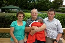 Diane and David Broderick with David Sullivan, 19, and a baby they're looking after. Photo / Supplied