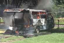 A van is ablaze at Pikowai Campground in Matata. Photo / Glenys Hennessey
