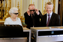 The Queen watches a recording of her Christmas message in 3D. Photo / AP 