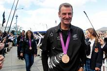 Sir Mark Todd leads the NZ bronze medal-winning eventing team through a guard of honour from the Cambridge Pony Club after the Olympic Games.  Photo / Christine Cornege 