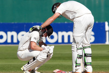Kane Williamson is comforted by Martin Guptill after being hit by Dale Steyn. Photo / Mark Mitchell