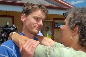 Wellington mountain runner Alastair Shelton hugs his mother Rachel McCahon after spending two days lost in the cold and rain. Photo /  Wairarapa Times-Age