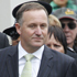 Prime Minister John Key is lead onto the marae by Titewhai Harawira. The National Party visits Te Tii Marae the day before Waitangi Day. Photo / Natalie Slade