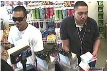 Police investigating Tuesday's armed robbery on the corner of Victoria and High Sts, central Auckland, want to identify these two men, sought in connection with a bag snatch last month. Photo / Supplied