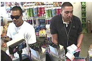 Police would like to identify and speak to these two men, who were involved in the January 19 incident at the Quiki Mart on Great North Rd in Henderson. Photo / supplied