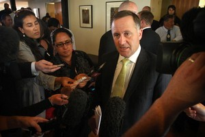 Prime Minister John Key talks to media at Waitangi. He's used his Waitangi Day breakfast address to defend some of his government's more controversial policies. Photo / Natalie Slade