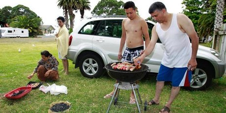 Regular visitors to Waiwera Thermal Resort (left to right) Hanifa, Mosheen, Mushtaq and Abdul Moses prepare a halal barbecue in a nearby park. Photo / Steve McNicholl