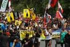 A large hikoi marches towards the Waitangi Treaty Grounds. Photo / Natalie Slade