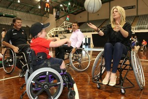 Seven year old Jaden Movold and Westpac Halberg Awards presenter Rachel Hunter play basketball. Photo /  Greg Bowker