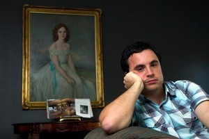 John Fraser fears he has lost an inheritance from his grandmother Lela Vincent (pictured in painting behind). Photo / Simon Baker