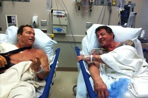 Arnold Schwarzenegger released this picture of himself and Sylvester Stallone in adjacent hospital beds. Photo / Supplied