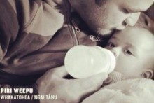 This scene of All Black Piri Weepu bottle-feeding his baby daughter was constroversially cut from a health campaign ad. Photo / Supplied