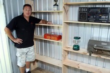 Greig Morgan's shelves offer plenty of space to store jars of screws and other goodies. Photo / Janna Dixon