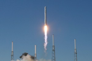 SpaceX's Falcon 9 rocket blasts off from Cape Canaveral, Florida in this file photograph. The new SuperDraco engine will be used to launch a rescue vehicle for crew. Photo / AP