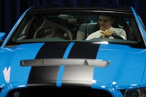 President Barack Obama sits inside a Ford Mustang Shelby GT500. Photo / AP