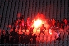 Egyptian fans clash with riot police following Al-Ahly club soccer match against Al-Masry club at the soccer stadium in Port Said last week. Photo / AP