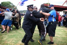 Security and Maori wardens grapple with a protester on Waitangi Day. Picture / APN