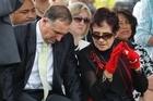 Prime Minister John Key listens to Titewhai Harawira at Waitangi. Photo / Natalie Slade