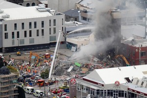 The rubble of the CTV Building on the evening of the February 22 Christchurch earthquake. Photo / Mark Mitchell