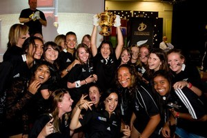 Renee Clark, 17, holds the Webb Ellis Cup above her classmates during the trophy's visit to Pukekohe High School yesterday. Photo / Dean Purcell
