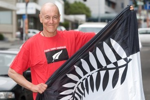 Lloyd Morrison, pictured in 2010 with one of the alternative New Zealand flag designs. Photo / Mark Mitchell