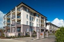 The four-storey Summerset by the Park complex has a mix of villas and apartments. Picture / Supplied