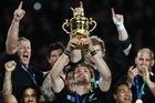 All Black captain Richie McCaw hoists the trophy aloft after the All Blacks won the Rugby World Cup. Photo / Supplied
