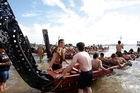 The waka fleet prepares to leave Ti Beach during Waitangi Day activities. Photo / APN