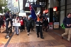 Asset sales protesters make their way down Lambton Quay today. Photo / APNZ