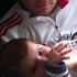 Cintia sends in this photo of husband, Roland Verran feeding baby Lola. Photo / Cintia Verran