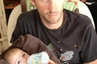 Bevan Docherty yesterday posted an image of himself feeding his 6-month-old son, Fletcher, on Twitter. Photo / Supplied