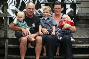 Craig Bradley and Carla Bradley with their three sons, Jayden (15 months), Alex (11 months) and Cane (3), at their rented home in Papakura. Photo / Greg bowker