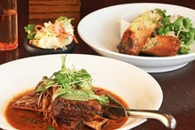 MooChowChow's slow-cooked beef rib with Thai basil in red curry and crispy pork roll. Photo / Greg Bowker