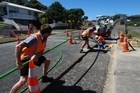 Workers laying fibre optic cabling. Photo / supplied