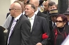 Prime Minister John Key is escorted by Titewhai Harawira at Waitangi. Photo / nzherald.co.nz
