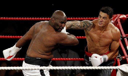 Sonny Bill Williams lands a punch on Clarence Tillman last night.