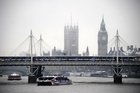 Forecasters say the miserable weather in London is set to continue. Photo / AFP