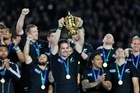 Richie McCaw lifts the Rugby World Cup. Photo / APN